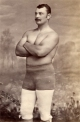 New York policeman Bill Muldoon (1845/1933) claimed (in the USA) to be World Champion